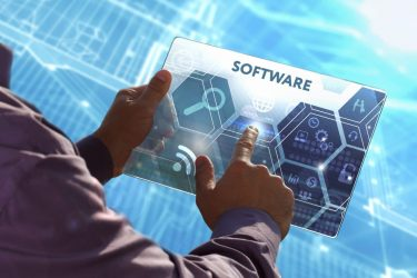 Business, Technology, Internet and network concept . Young business man working on the tablet of the future , select the virtual screen: Software