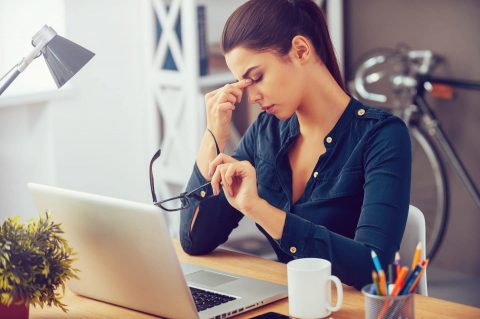 Stressed woman: are you talking about staff wellbeing?